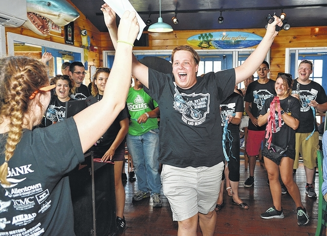 Jimmy Musto, of Jenkins Township, is thrilled to have his name picked in one of the many raffles at the Fourth Annual Dr. Jen's Hope Motorcycle Rally and Block Party at Cooper's Seafood House and Cabana in Pittston.